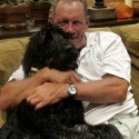 Charlie the labradoodle with George Brett